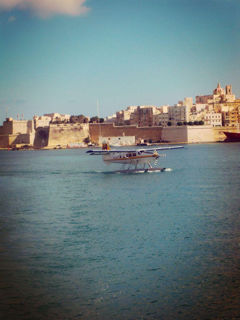 Plane landing in Valetta Harbour, Malta